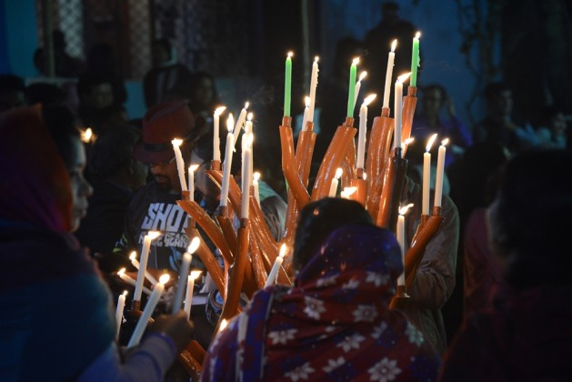 Pilgrims are lighting candles in Diang Pilgrimage
