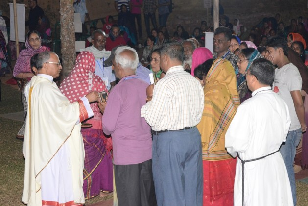 Pillgrims in Diang are receiving communion from Bp. Subrato