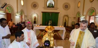 A pilgrim touching St. Anthony's Relic for Blessings