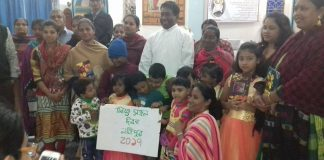 Fr. Robert Gonsalves with Children of Shahebganj