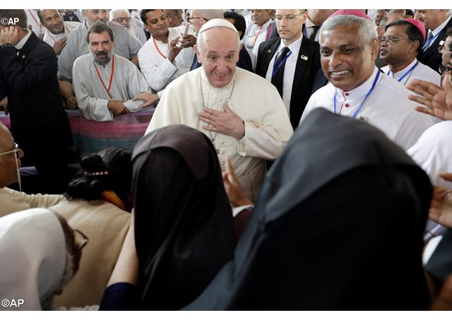 Pope Francis, is greeted by nuns as he arrives for a meeting with priests, men and women religious, seminarians and novices at the Church of the Holy Rosary, in Dhaka, Bangladesh - AP