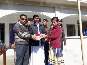 A student Receiving books from UP Chairman