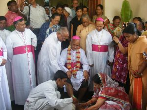 Father Philip is receiving Bishop Moses as the new Bishop of Chittagong-2011