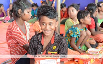 A smiling Rohingya child during the 'share a meal' campaign