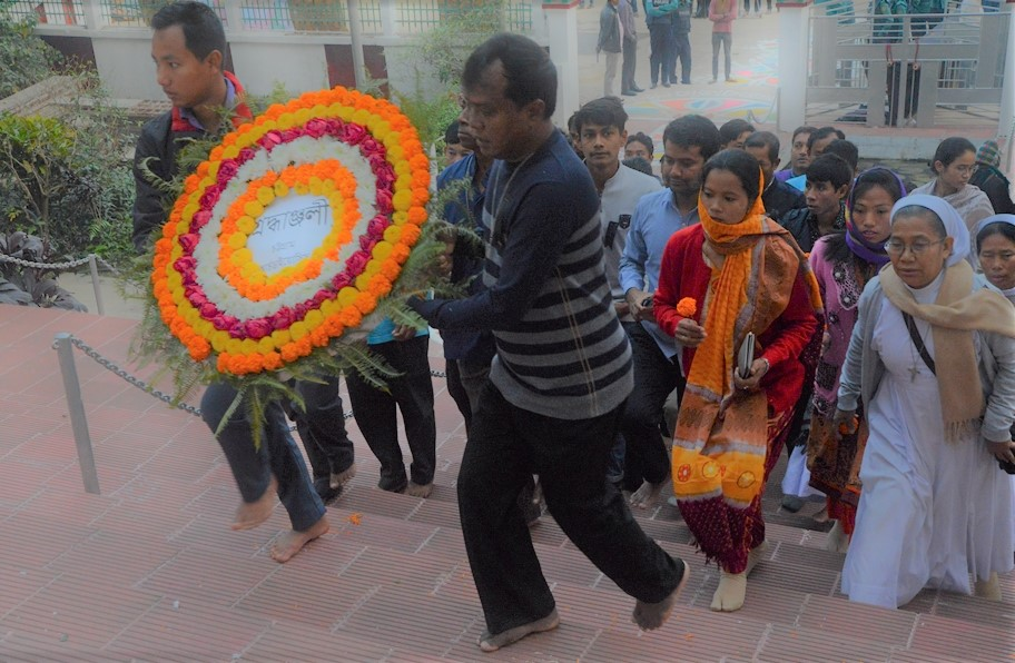on the steps of central Shahid Minar, Chittagong to offer flowers to the Language Martyrs