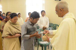 Archbishop Moses distributing communion